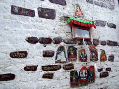 The Barkhor district is one of Lhasa's holiest areas with pilgrims prostrating and spinning prayer wheels, in between worshipping at makeshift shrines such as this one