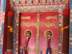 A bright red door at Norbulingka