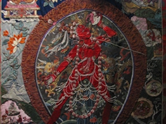 Fine details of a pure silk Thangka on display at the Tibet Museum