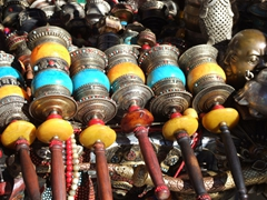 Colorful prayer wheels for sale, typical of what we saw at most of the street vendor stands