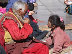Portrait of an elder monk teaching life long lessons to a young girl