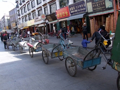 Pushcarts lined in a row; Barkhor