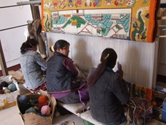 Women weaving a Tibetan style carpet; too bad the prices were so outrageous!