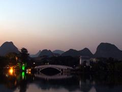 Dusk view of the limestone peaks surrounding Banyan Lake; Guilin