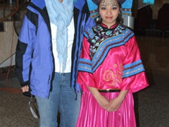 Becky strikes a pose beside a ornately decorated performer