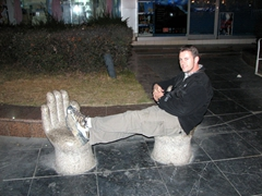 Robby rests on some hand stools; Guilin