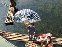 "Massive silk fan on offer for a ""cheap price""...its amazing what the raftsmen bring up alongside our cruise to hold up for sale"