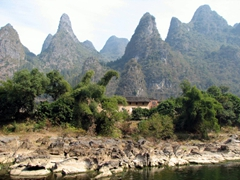 Jagged limestone peaks stretch on as far as the eye can see; Lijiang River