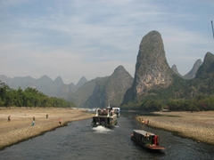 Cruise ships steam full speed ahead down the extremely shallow Lijiang River (we could easily see the riverbed and marveled that no one bottomed out)