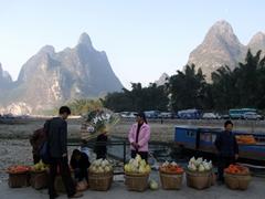 Fresh fruit vendors tout their wares; Li Riverbank