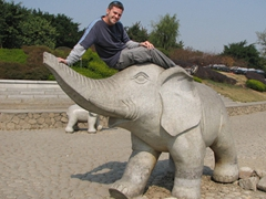 Robby decides to hop on his own elephant at Elephant Trunk Hill