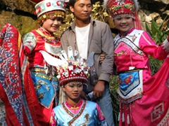 This Chinese tourist takes a colorful portrait with costumed minorities, Seven Star Park