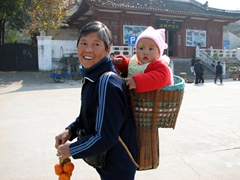 We finally got a huge grin out of this woman after buying several oranges from her...the baby on her back photo was too cute to pass up!