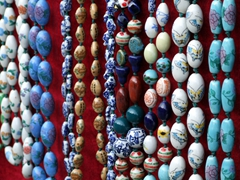 Detail of beaded necklaces for sale on souvenir alley; Yichang