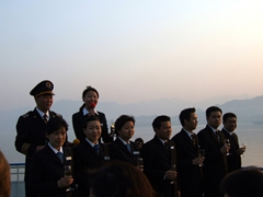 Snapshot of Princess Elaine's crew singing a welcome tune