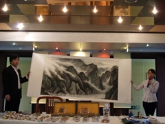 Adam displays his Chinese style paintings in the ballroom and conducts a short but fascinating demonstration