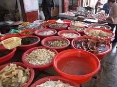 Buckets of produce for sale; Wanxian market