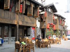 Traditional tea shops line the exterior of the complex, providing an inviting place to sip a cup of tea
