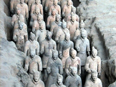 Pit 1 showcases 6000 terracotta figures of warriors and horses facing east in a rectangular battle formation