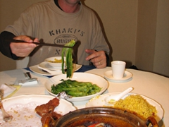 Robby thoroughly enjoys our Cantonese meal at the Horizon Restaurant where we enjoyed deer ribs, pork in a hot pot, noodle soup, grilled vegetables and fried rice
