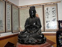 A serene Buddha sits inside the Big Goose Pagoda
