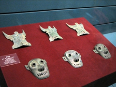 Ancient face masks stare back ominously from the museum's display case