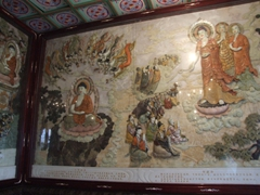 Inside one of the Big Wild Goose Pagoda's hallways, a colorful depiction of the life and death of Buddha is prominently displayed