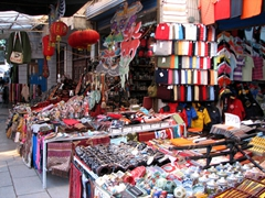 Chen jokingly told us that the Muslims are excellent businessmen. In order to visit the Great Mosque, we first had to walk down this covered bazaar alleyway, with its gorgeous and eye catching assortment of souvenirs for sale