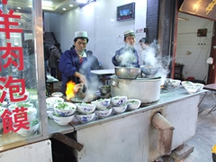 Hot, steaming bowls of noodle soup catch our eye (and our stomachs attention) in the Muslim Quarter