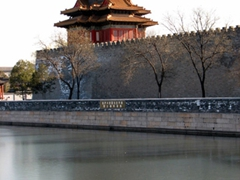 Exterior wall of the Forbidden City. A guard tower stands prominent, with a palace moat surrounding the entire complex