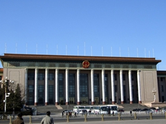 Tiananmen Square is flanked by imposing buildings such as The Great Hall of the People
