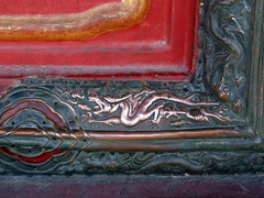 Dragons are carved and etched in the window and door frames of many buildings in the Forbidden City