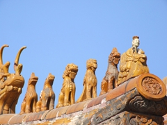 Detail of a Forbidden City rooftop with 7 figurines (the figurines are always odd numbered in series of 3, 5, 7, or 9 with more figurines showing the social position or power of the owner)