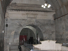 View of the underground tomb (notice the huge archways, and stone throne in the foreground)