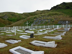 View of the peaceful Grytviken cemetery, which contains not only the remains of whalers and sealers, but also the grave of explorer Sir Ernest Henry Shackleton