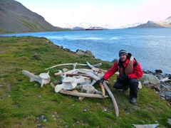 Robby beside whale bones; remnants of Grytviken's exploitation of whales
