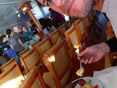 Robby enjoys his BBQ meal after our visit to Grytviken Whaling Station; Polar Star