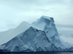 "Imagine that only 10% of this iceberg is visible above the surface. The remaining 90% is below water, and continual calving can lead to ""shooters"" as icebergs rise rapidly to the surface from the hundreds of feet of submerged ice"