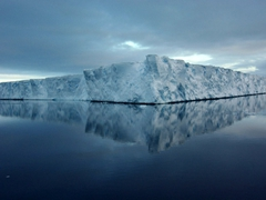 A large tabular iceberg with a perfect mirror reflection; near Paulet Island
