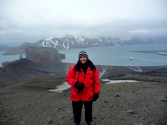 Robby standing at the peak of Whaler's Bay, overlooking Neptune's Bellows on Deception Island