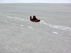 Becky's favorite part of the hike is the glissade down! Here she is headed towards Neptune's Bellows on Deception Island