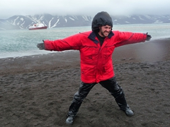 Robby tries to fight the gale with limited success; Whaler's Bay on Deception Island