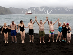 The few, the proud and the crazy just before entering the freezing waters of Deception Island. From L to R, Pat Brown, Robby, Becky, Mark Rentz, Vick Cooper, Dr Ross, Jess Faller, Therese Faller, and Jana Kristin