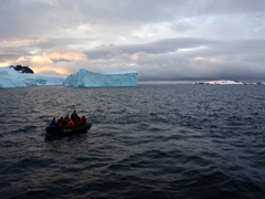 It is 10 pm and there is still sunlight as the last zodiac departs Cuverville Island
