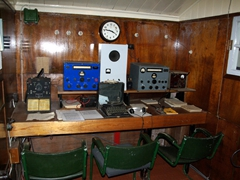 Port Lockroy's comms room. The island was discovered 1903 by the French Antarctic Expedition, and used for whaling and British military operations during World War II. It continued to operate as a British research station until 1962