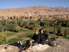 Posing in front of a beautiful mud built village; near Todra Gorge, Morocco