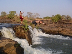 An image frozen in time...Luke kicks Robby into the Chutes de Karfiguela; Burkina Faso