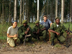 Posing with our Angolan guards who roamed about our campsite armed with AK47s near Yema; Angola