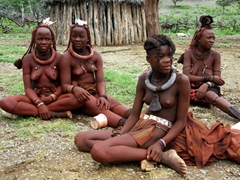 We found the Himba tribal people to be fascinating, with their mud baked hair and ochre reddened skin; Namibia