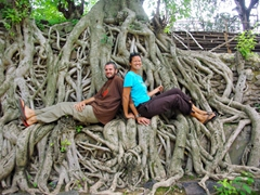 Posing on the roots of trees at Gondar's Fasiledas Bath; Ethhiopia